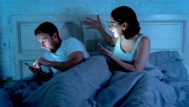 Cheating spouse, a couple in bed