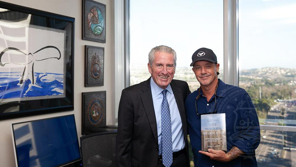 Private investigator Thomas G. Martin with artist and conservationist Wyland.